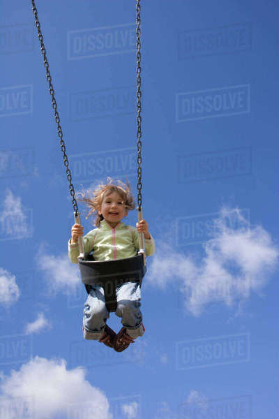 Girl on swing, low angle Royalty-free stock photo