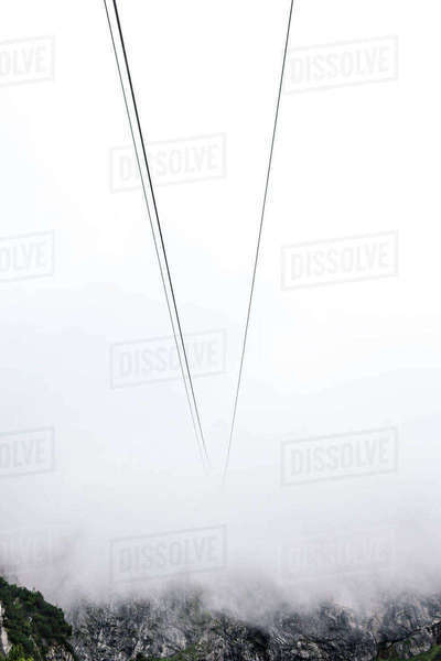 Cable car wires disappearing into mist, Brand, Vorarlberg, Austria Royalty-free stock photo