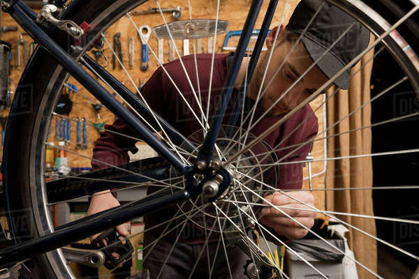 Technician in bicycle workshop Royalty-free stock photo