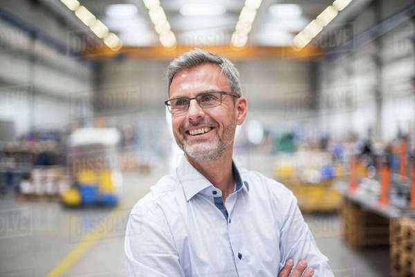Portrait of happy male engineer in engineering factory Royalty-free stock photo