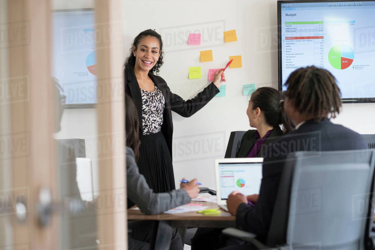 Businessman And Businesswomen In Office Brainstorming Stock Photo
