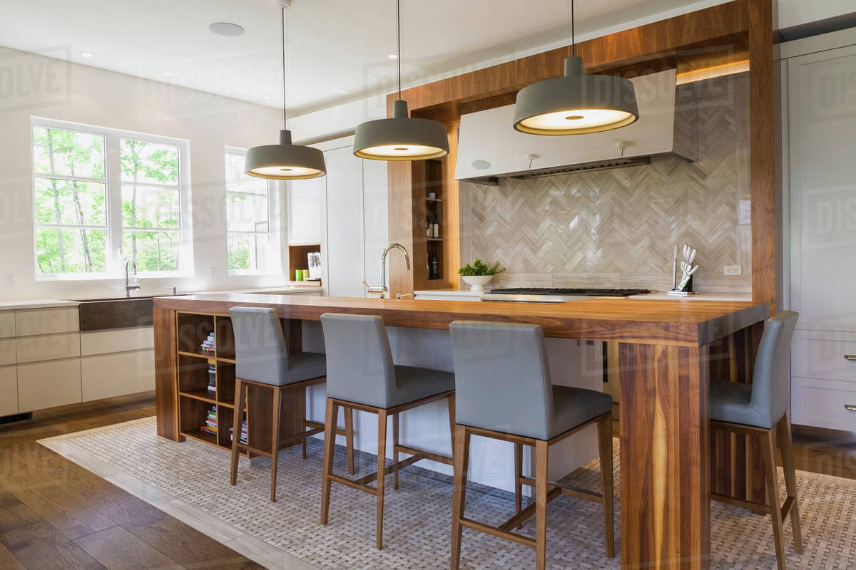 Walnut wood kitchen island in a luxurious contemporary home D25_157_079