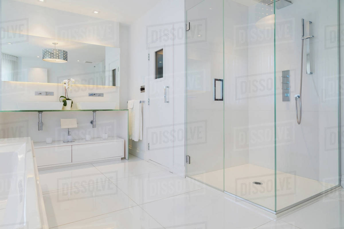 Detail Of White Rectangular Bathtub Wall Mirror Glass Shower Stall And Sauna Room Door In En Suite With Ceramic Tile Flooring Upstairs Inside