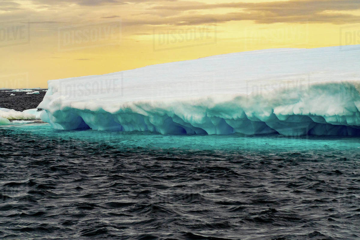 Close up of a glacier on the Antarctic sea, blue underneath and white above. Royalty-free stock photo