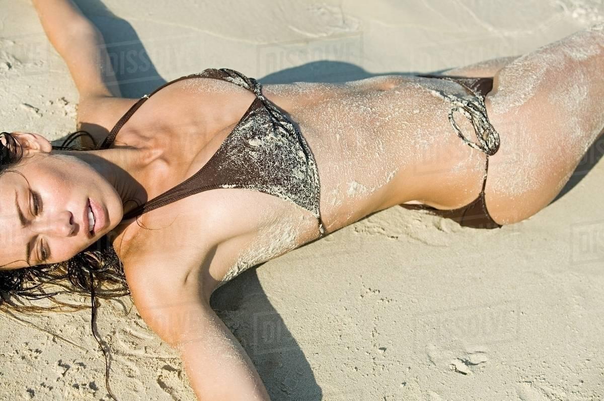 Beach woman lying on Woman Lying