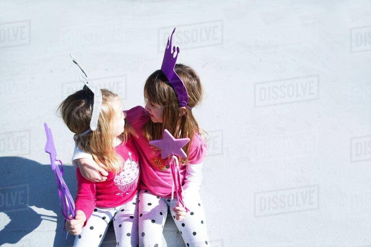Two young sisters dressed up as fairies holding wands Royalty-free stock photo