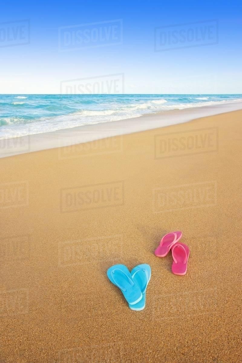 7fb036009 Flip flops discarded on the beach - Stock Photo - Dissolve