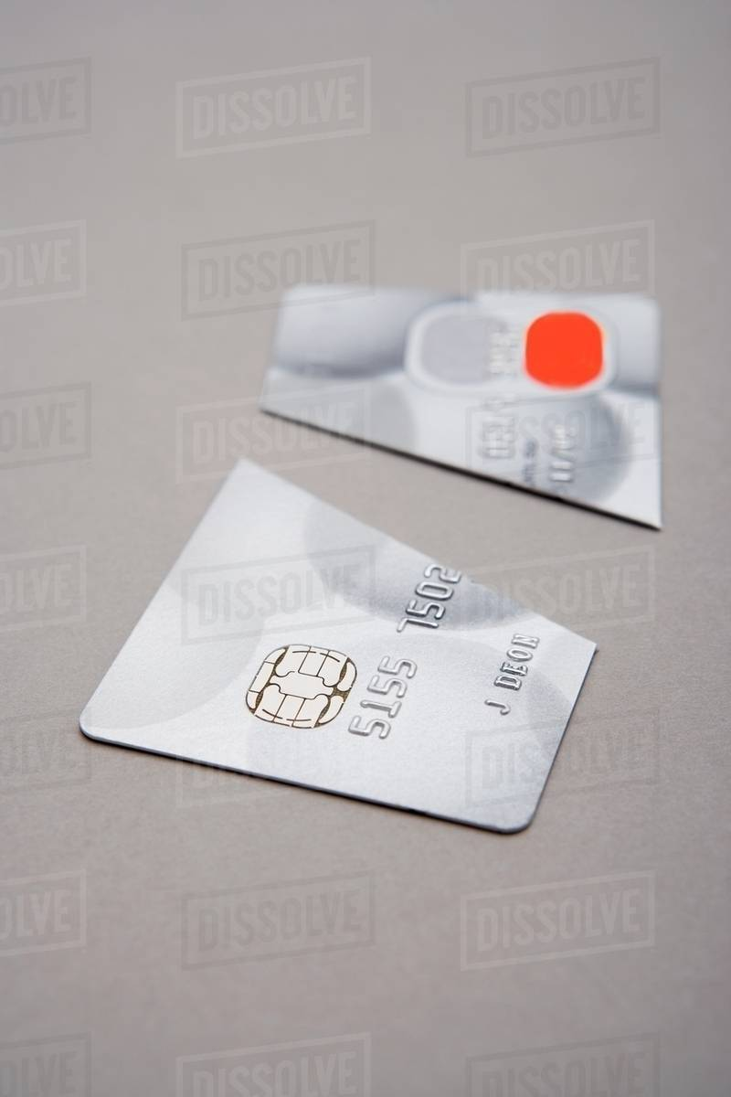 Credit card cut in half - Stock Photo - Dissolve