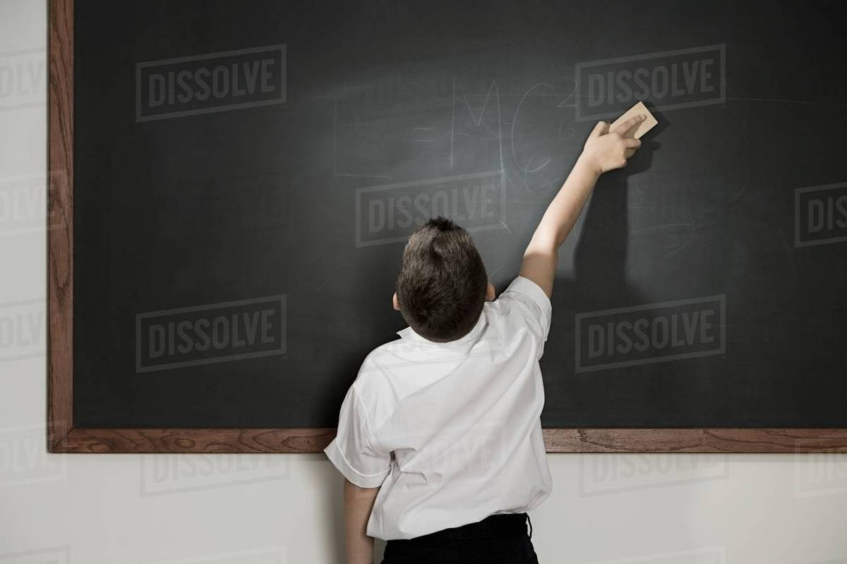boy cleaning blackboard stock photo dissolve. Black Bedroom Furniture Sets. Home Design Ideas