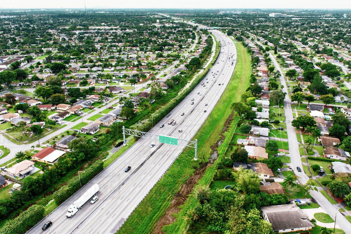 Aerial view of highway through residential area, Miami, Florida, USA stock  photo