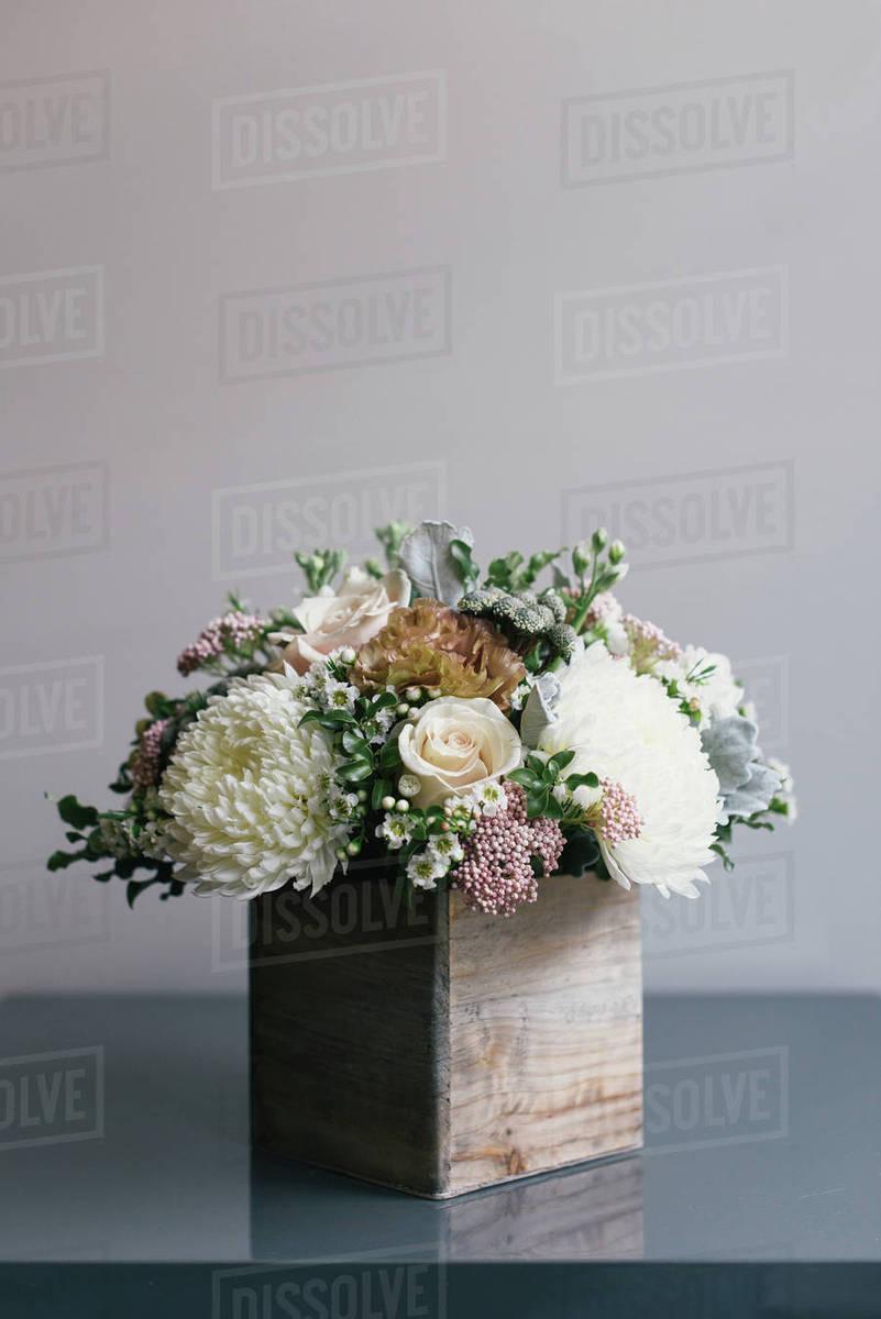 Flower Arrangement In Wooden Box Close Up Stock Photo Dissolve