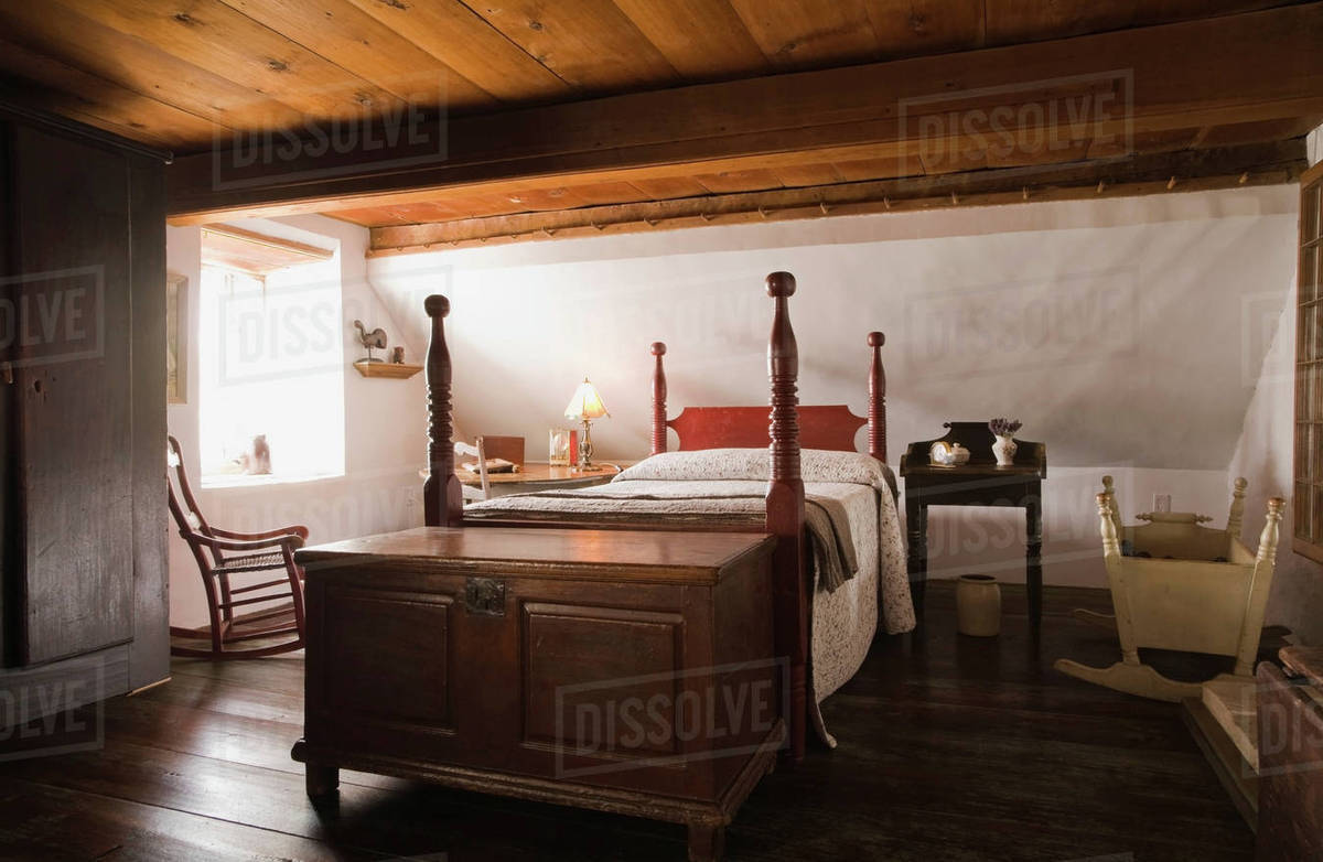 Double Bed And Old Wooden Storage Chest In The Master Bedroom In Old 1785 Fieldstone Cottage Style Residential Home Quebec Canada Stock Photo Dissolve