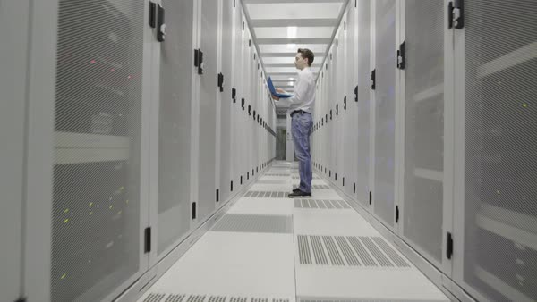 WS MS Man standing with laptop in data center / Amsterdam, North Holland, Netherlands Royalty-free stock video