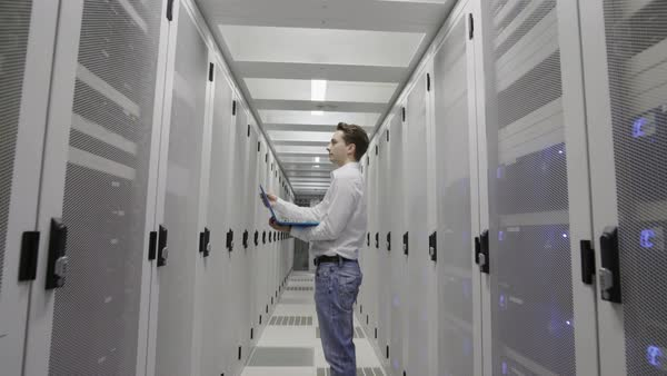 MS Man standing with laptop in data center / Amsterdam, North Holland, Netherlands Royalty-free stock video