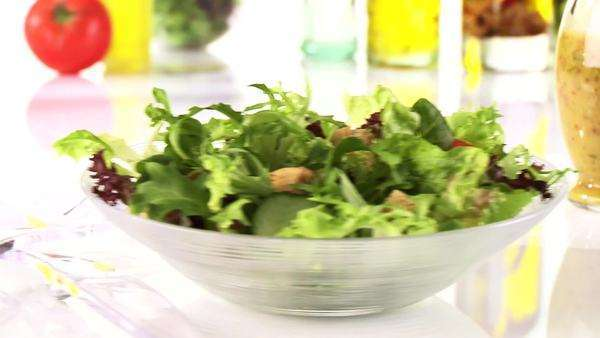 Putting dressing on mixed salad leaves Royalty-free stock video