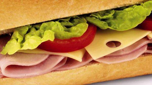 Ham, cheese, tomato and lettuce in baguette Royalty-free stock video