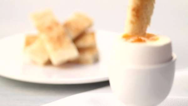 Boiled egg and soldiers (strips of toast, UK) Royalty-free stock video