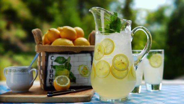 Glass jug of lemonade out of doors Rights-managed stock video