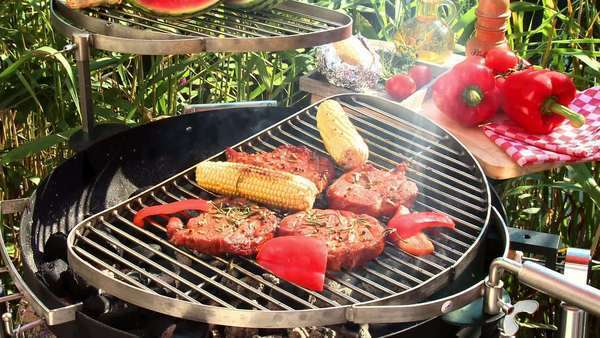 Pork neck steaks with corn on the cob and peppers on barbecue Rights-managed stock video