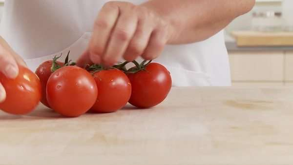 Removing a tomato from the vine Rights-managed stock video
