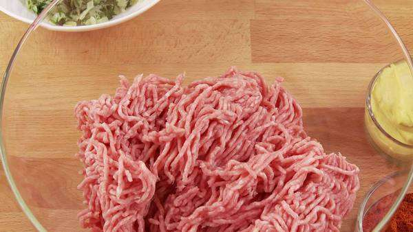 Minced meat being mixed with other ingredients Rights-managed stock video