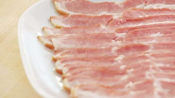 Rashers of bacon on a plate Royalty-free stock video