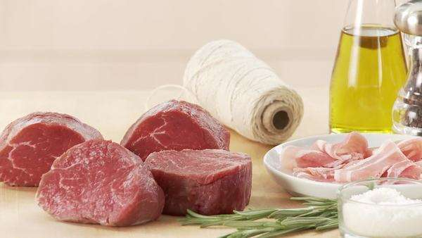 Fillet mignon, rashers of bacon, kitchen twine and spices Royalty-free stock video