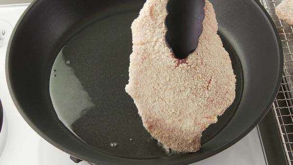 A breaded escalope being fried in a pan Royalty-free stock video