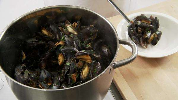 Cooked mussels being arranged on a deep plate Royalty-free stock video