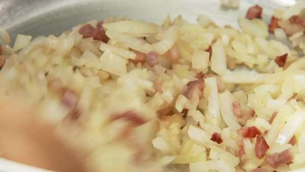 Onions being fried with diced bacon Royalty-free stock video