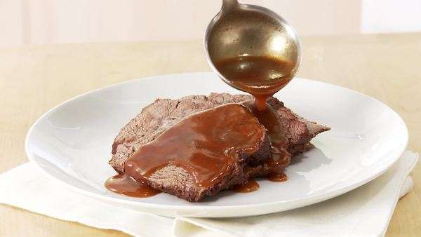 Beef pot roast being served with gravy Royalty-free stock video