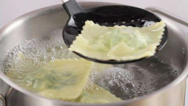 Ravioli being removed from boiling water with a draining spoon Royalty-free stock video