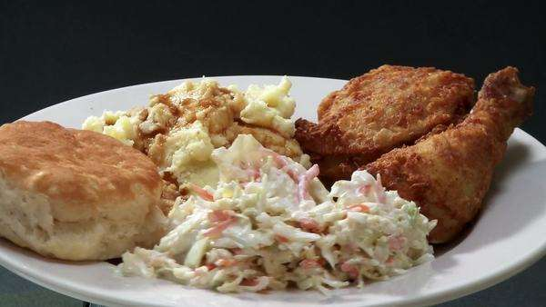 Deep-fried chicken pieces with coleslaw and potato salad Royalty-free stock video