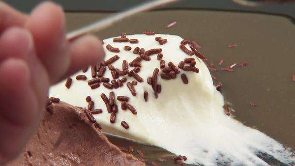 Brown & white mousse au chocolat with chocolate vermicelli Royalty-free stock video