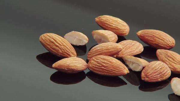 Almonds with melted chocolate Royalty-free stock video
