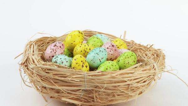 Coloured quails' eggs in Easter nest Royalty-free stock video