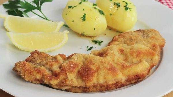Wiener Schnitzel (breaded veal escalope) with parsley potatoes Royalty-free stock video