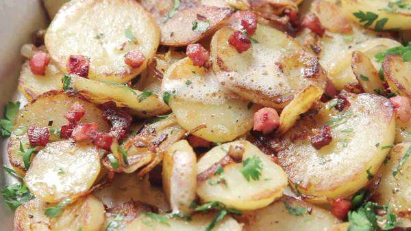 Sauté potatoes with lardons and parsley Royalty-free stock video