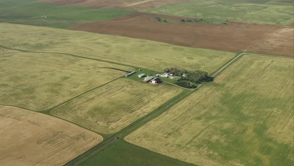 An aerial view of a large farm and the surrounding crops Royalty-free stock video