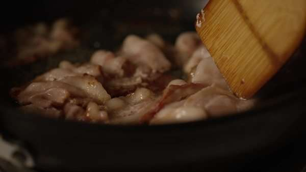 Canadian bacon frying in a pan on a stove Royalty-free stock video