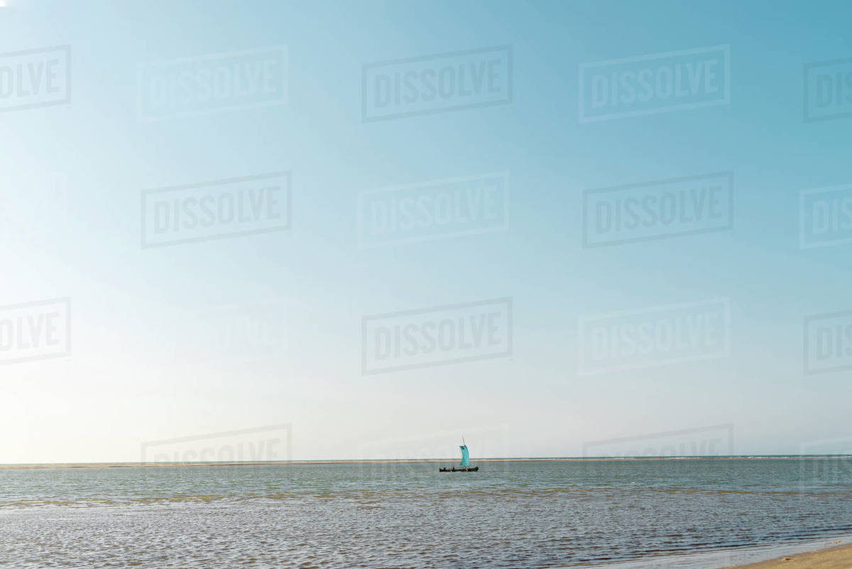 Fishing boat with sail close to the beach at sunset  in Morondava, Madagascar Royalty-free stock photo