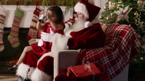 Santa Claus shows little girl a snow globe Royalty-free stock video