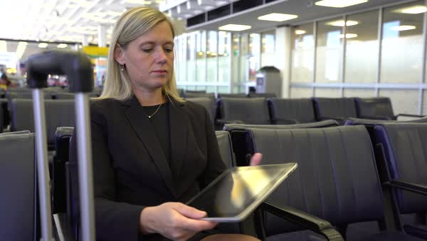 Business woman using digital tablet at airport Royalty-free stock video