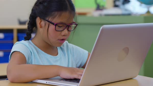 Girl in school classroom working on laptop computer Royalty-free stock video