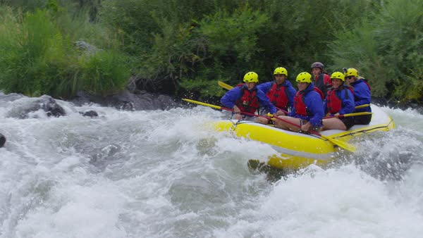 Group of people white water rafting in slow motion Royalty-free stock video