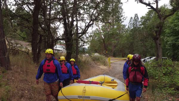Group of people white water rafting carry raft together Royalty-free stock video