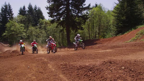 Motocross racers going over bumps Royalty-free stock video