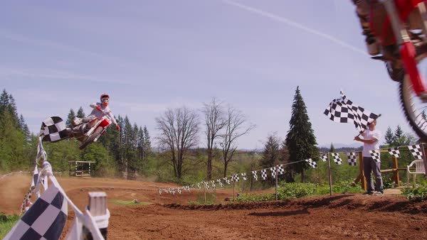 Motocross racers going over big jump in slow motion Royalty-free stock video
