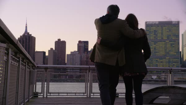 Couple in New York City walk down pier Royalty-free stock video