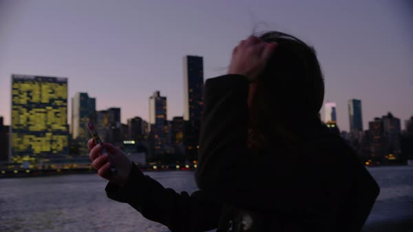 Woman in New York City taking photos of city with cell phone Royalty-free stock video